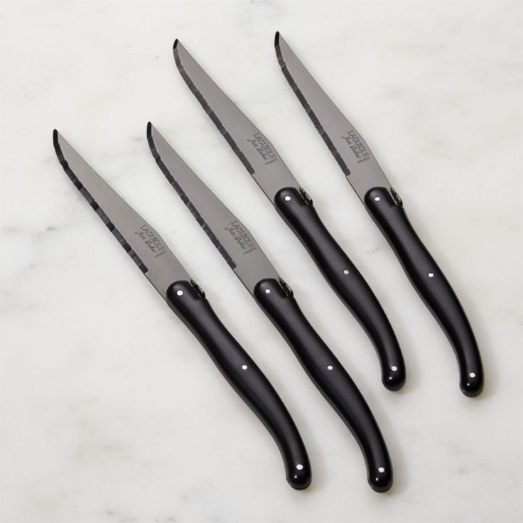 Free Shipping.  Shop Laguiole ® Black Steak Knives Set of Four.  Black-tinted blades add a modern edge to Laguiole's famed serrated steak knives with signature contoured, riveted handles.
