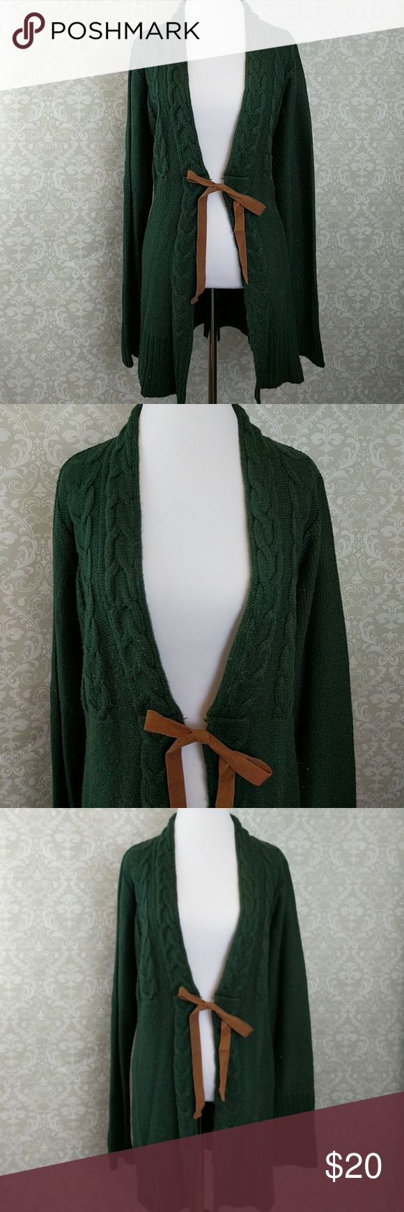 Perfect Green Sweater I love this sweater! I just don't work a job that would allow me to wear it, so it has sat in my closet unloved for too long! This sweater is perfect for fall in winter. It's the perfect shade of green. It has brown faux suede ties in the front. Fits slightly small and is in good condition. If you have any questions please leave a comment. Maurices Sweaters