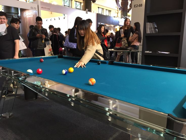 Shanghai. Who said billiard is just for men?  Girl playing on Filotto crystal glass pool table.   #billiard #design #madeinitaly #gameroom #interiors #table #furniture #luxury #custom #crystal