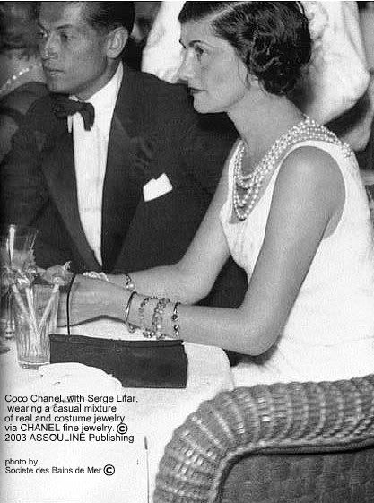 Coco Chanel (54) and Serge Lifar - 1937 - She is wearing a casual mixture of real and costume jewelry. with <3 from JDzigner www.jdzigner.com