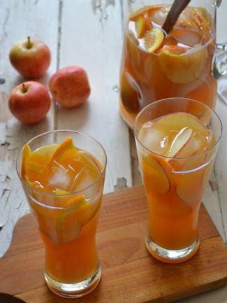 Happy Hour: Hard Cider Sangria      1-2 Cups Thinly Sliced Apples     1 Cup Thinly Sliced and Quartered Orange Slices     2 Cups Unfiltered Apple Juice     ½ Cup Whiskey (Makers Mark or Buffalo Trace)     2 Tablespoons Fresh Lemon Juice     24 Ounces Hard Apple Cider (Woodchuck or Crispin)     Ice