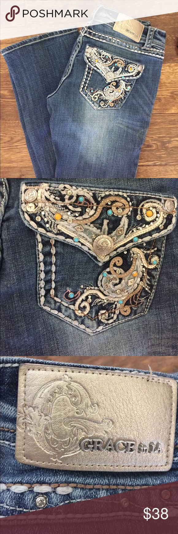 Bling jeans No sign of wear on bottom, orange and turquoise stone detail on pocket design! Only worn once, and are super cute with cowboy boots! Grace Jeans Boot Cut