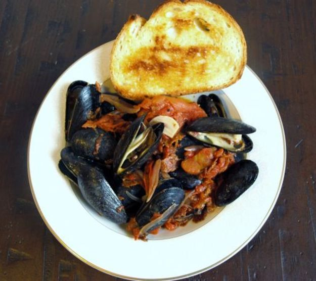 Mussels in Chorizo and Tomato Broth -- Rendered chorizo adds great flavor and heat to this quick dinner dish.