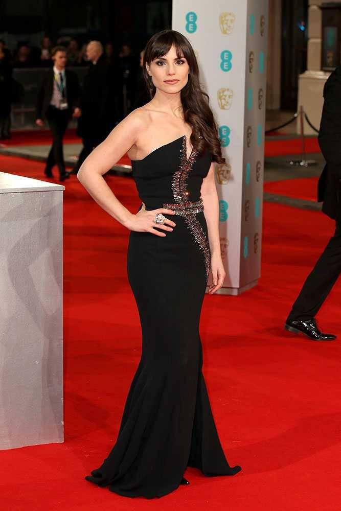 Charlotte Riley, in Antonio Berardi, attends the 2015 BAFTA Awards, London.