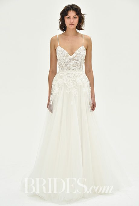 "Brides.com: . ""Elana"" tulle wedding dress with sheer v-neck bodice featuring floral crystal detailing, Christos"