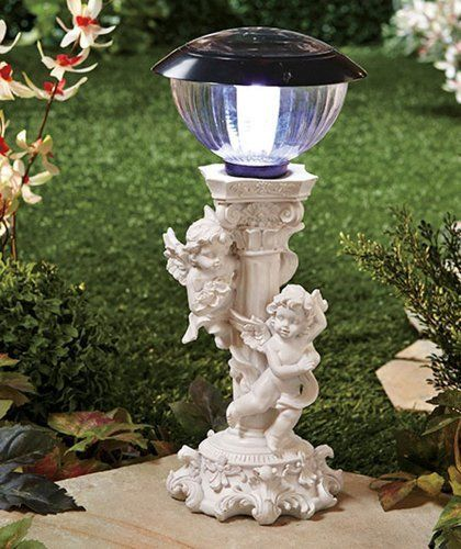 """Solar Cherub Light by ABC. $27.99. solar changing cherub. automatically turns on at night. LED rechargeable light. 14"""" tall. Make your garden glow with the heavenly hosts of the Solar Cherub light. It shines through the night, fueled by power collected from the sun during the day. The white light tops the pedestal-style statue. Place it on a lawn, porch, garden or patio. Includes an on/off switch. 14-1/4"""" x 6-1/4"""" dia. Cold cast ceramic.      Intricate carved details make this th..."""