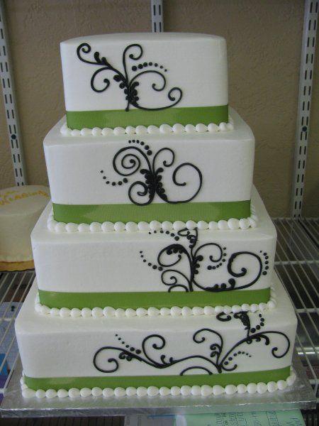 4 tier Green and black wedding cake. Attire