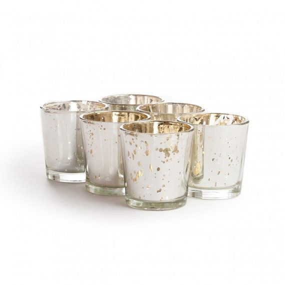 Kit & Caboodle  These gracefully tapering Mercury Glass Votive Holders are a must have item for any elegant event. The glass candle holders measure 2.5 Height x 2.25 Diameter are coated with a dappled silver finish to give your tables and arrangements a shimmering glow. Each holder fits standard size votive candles and tea lights   You will receive 30 of these silver mercury glass votive holders
