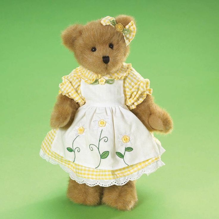 April 2009 Boyds Bear of the Month! Daisy is the picture of sunshine and happiness in her yellow gingham dress. Dress features eyelet trim and ruffled collar and sleeves to match her earbow with button and leaf accent. Daisy wears an whilte apron with da