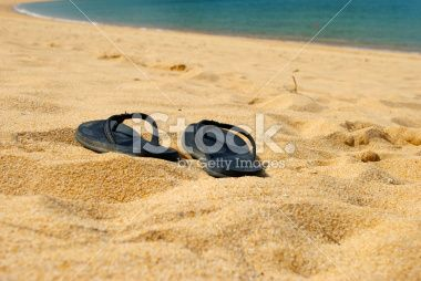 Beach Summer Seascape, Jandals in golden sand Royalty Free Stock Photo