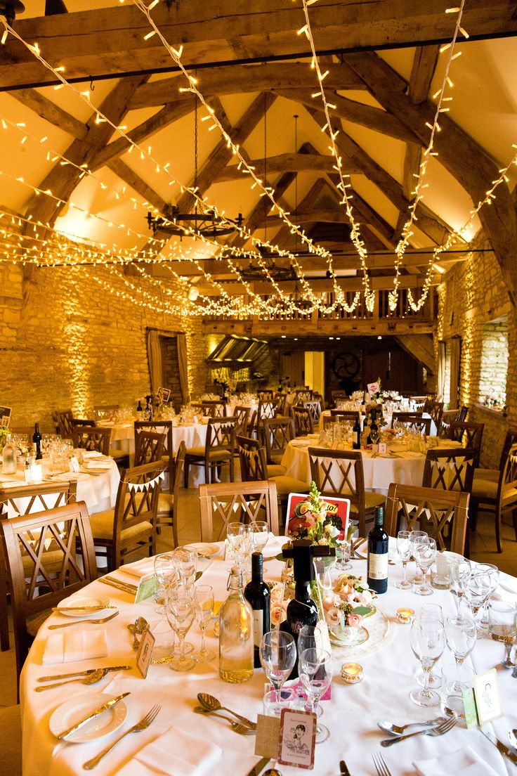 Caswell House is an exclusive Oxfordshire Cotswold barn wedding venue offering a stylish and romantic setting for your special day. Photo credit: Tom Weller.