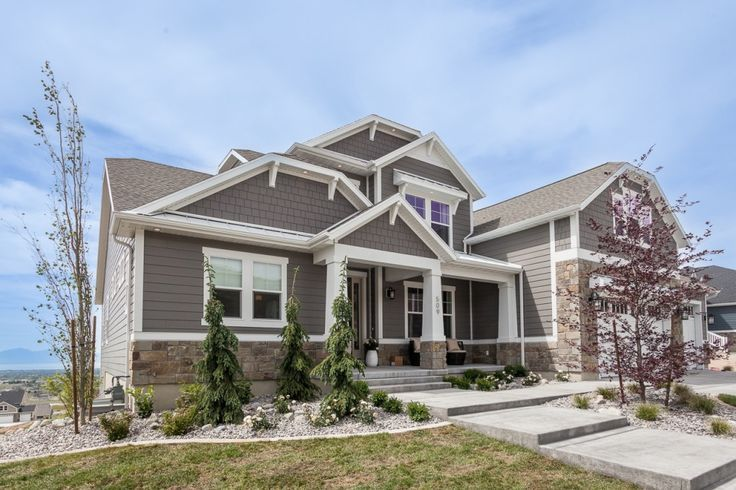 Edge 2015 Parade home, exteriors by Contractor Resource- Lap and shake James Hardie Aged Pewter, Arctic White trim. Wind River Natural Stone