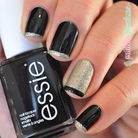 Black nails with sparkle french tip and opposite accent nail