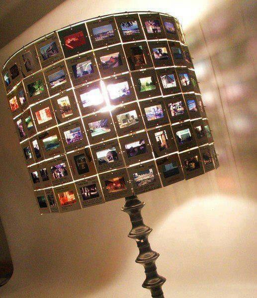 Cool idea for old projector slides. Just connect them with jump rings to a lampshade frame and voila!