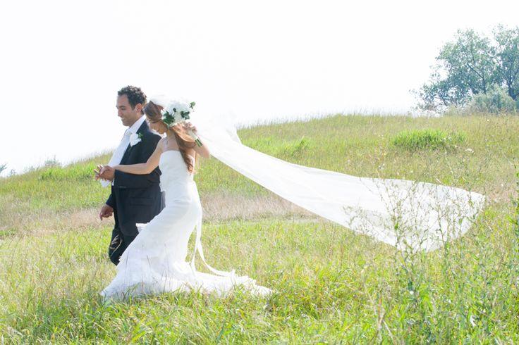 Copper Creek bride and groom walking in field
