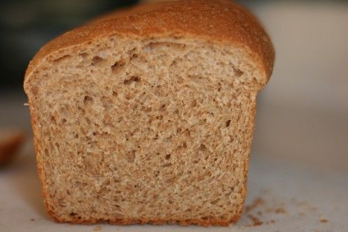 This is the best homemade bread recipe I have found so far. It yields an almost-perfect sandwich loaf, though it ends up being about 50% whole wheat once I add flour during kneading.