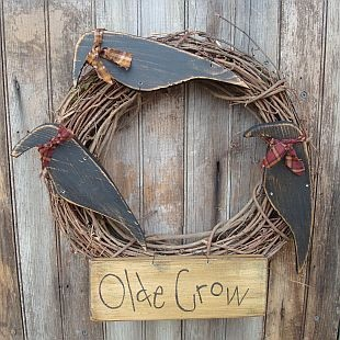 Like! just a plain grapevine wreath ans wooden crows and a piece of wood that says olde crow