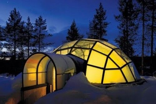 Igloo Village Kakslauttanen in the Arctic Circle in Finland. In wintertime, accommodations include snow igloos and glass igloos – yes, igloos! There's also a restaurant and a chapel for fairytale winter wonderland weddings. The glass igloos are built from a special thermal glass so the temperature inside the igloo is plenty toasty.