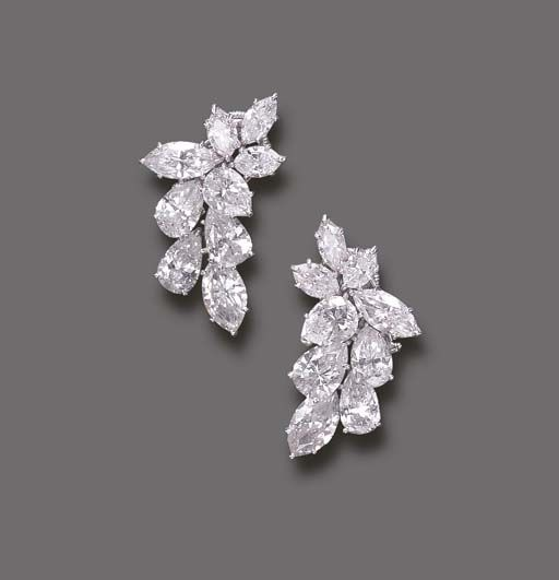 AN ELEGANT PAIR OF DIAMOND EAR CLIPS, BY HARRY WINSTON   Each designed as an articulated pear and marquise-cut diamond cascade, mounted in platinum  Signed Winston for Harry Winston