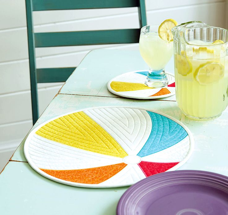 Add a touch of whimsy to a poolside table or springtime gathering. This easy to make beach ball placemat and mini mat project would be the perfect addition.