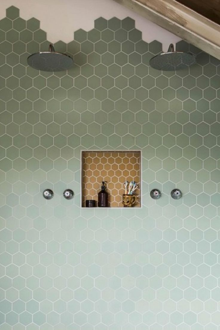 mixed color hex tile in a bathroom shower