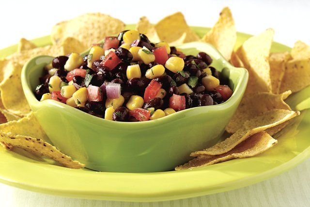 Black beans and frozen corn replace most of the fresh tomato in this zesty salsa, seasoned with cumin, cilantro, lime juice and garlic dressing.