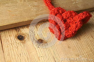 Heart-shaped knot on wood texture