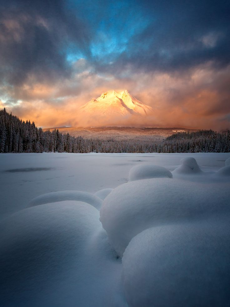 Breaking Through  Mt. Hood breaking through the clouds during a beautiful display of sunset color at Trillium Lake OR [OC] [9001200] #reddit