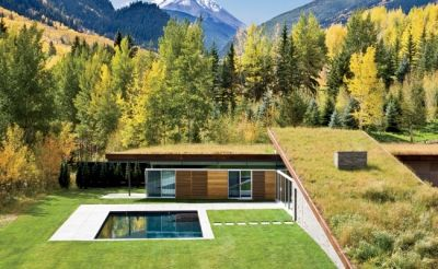 Gluck+, an architect-led design-build firm, tackled the challenge of preserving a breathtaking mountain vista view by embedding a guesthouse into the earth.