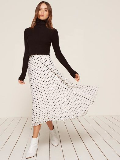 Looks great with a gust of wind. This is a pleated, ankle length skirt with a center back zipper.