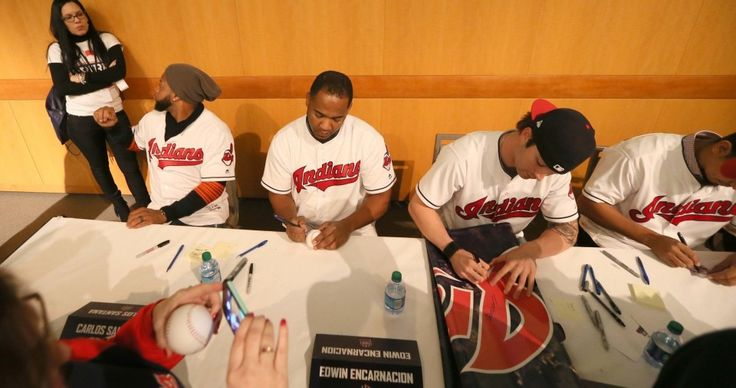 Signing autographs are Cleveland Indians Carlos Santana, Edwin Encarnacion, Tyler Naquin and Carlos Carrasco during 2017 TribeFest held at the InterContinental Hotel at the Cleveland Clinic, in Cleveland, Ohio, on Jan. 28, 2017.   (Chuck Crow/The Plain Dealer)