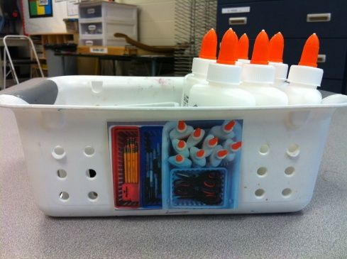 Take a picture of what supply bins should look like when put away properly. Students can't be dismissed until the bin looks like the picture.