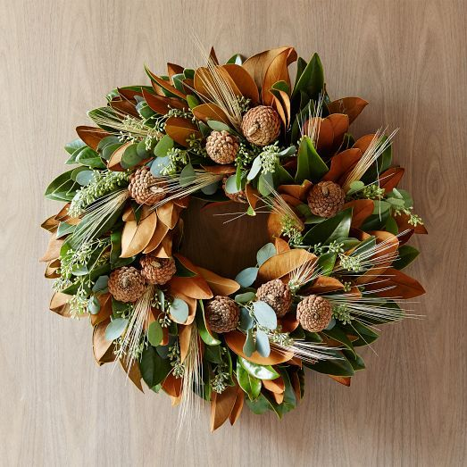 Made up of freshly cut seasonal plants, the Magnolia Wheat Wreath is artfully arranged to order. Magnolia leaves, pine cones and wheat give this arrangement a range of autumnal hues – and its fresh eucalyptus gives off a bright, energizing scent.