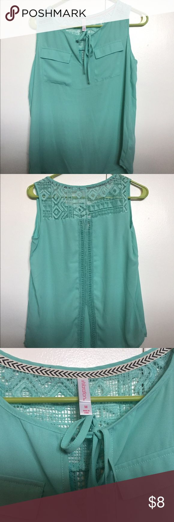 Mint green sleeveless top with lace back Medium xhilaration top from Target.  Mint green in color with lace detail on back. 100% polyester. Xhilaration Tops Blouses