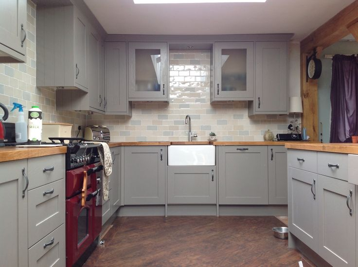 This is my kitchen. All done and dusted with carlisbrooke units in taupe from b&q and chic craquele tiles from topps tiles. Love love love!