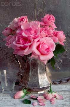 Antique teapots and trophies make beautiful vases and are so much more eye-catching when filled with flowers versus sitting empty on a shelf.