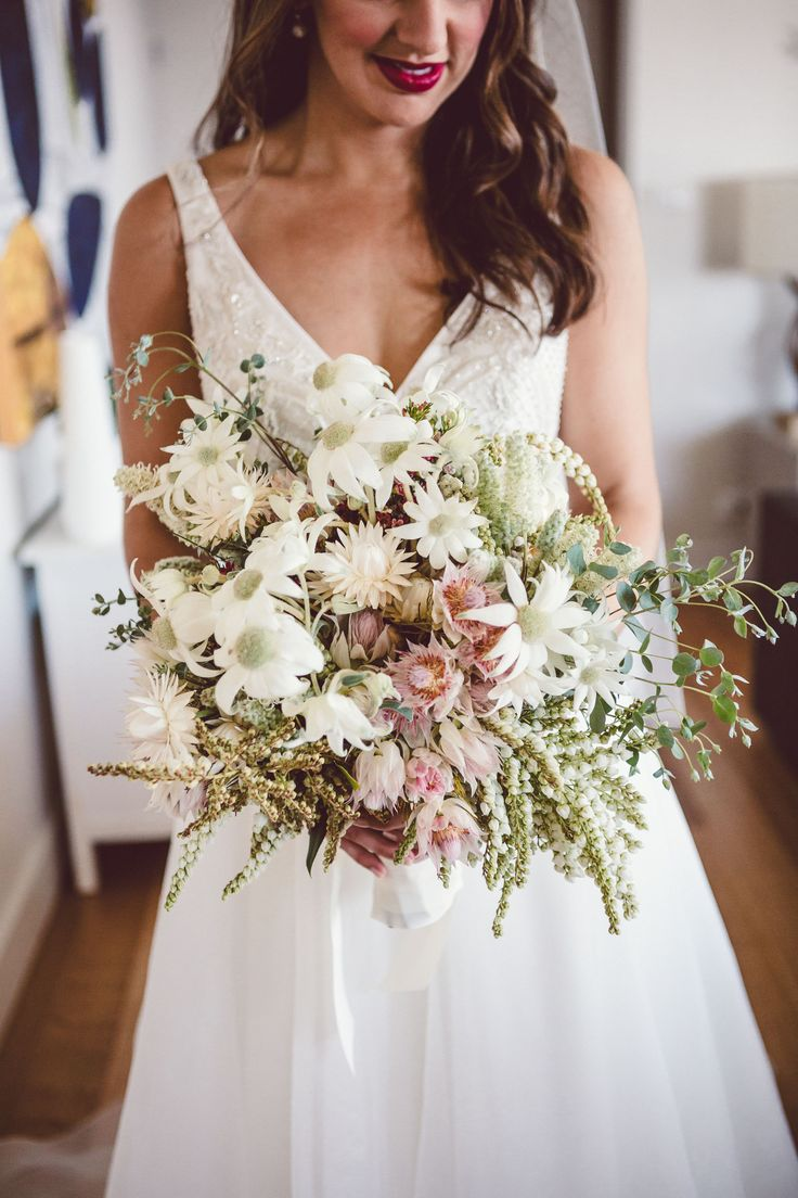 Bridal bouquet by Shady Fig using a native mix of flannel flowers, blushing brides, paper daisy and more. Photographed by Red Berry Photography.