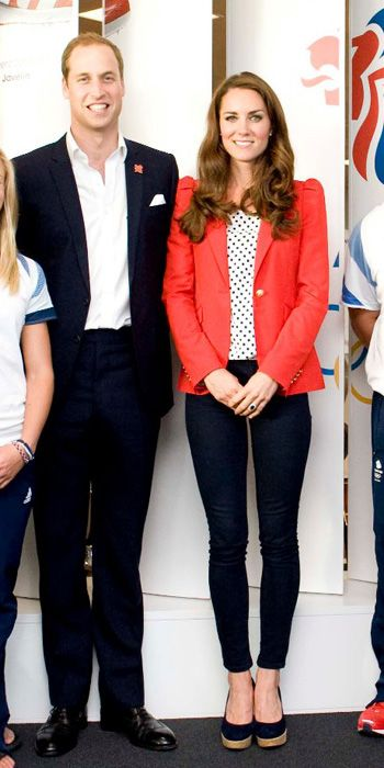 AUGUST 3, 2012 Middleton visited athletes on Team Great Britain in a polka-dot blouse, navy skinnies, Stuart Weitzman wedges, and a red Zara blazer.