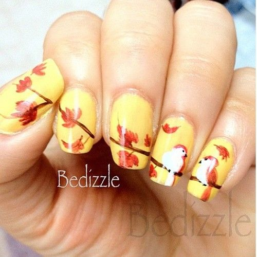 Yellow and brown Autumn leaves with birds on a branch nail art.  #nails #nailart…