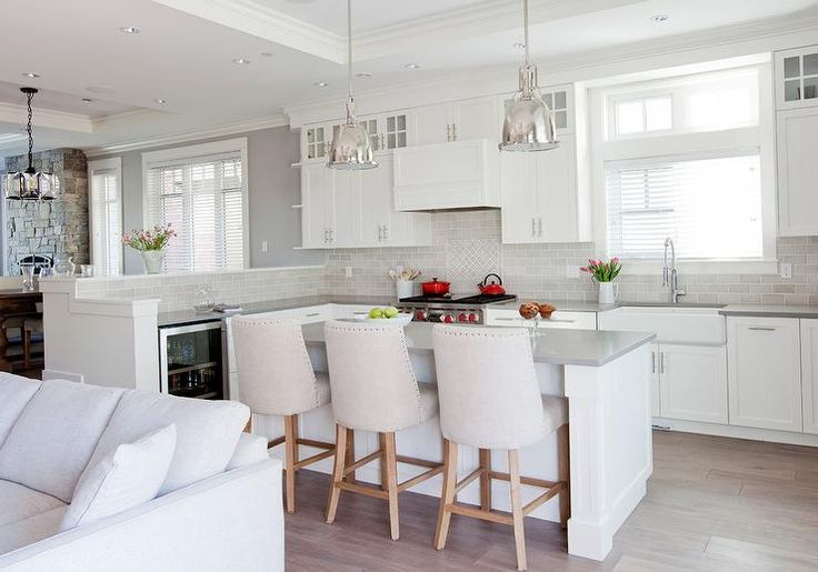 Restoration hardware benson pendants hang from a tray - Kitchen peninsula designs with seating ...