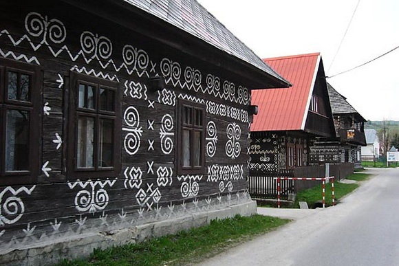 Čičmany is a village and municipality in the Žilina Region of northern Slovakia. It is known as the first folk architecture reserve in the world (founded in 1977). Timbered houses with ridge roofs, galleries and pointed or linear wall decorations have been preserved in Čičmany. Of particular interest are the very specific white patterns which are painted on the exterior walls of the houses to decorate them. The local folk music, special folk costumes and folk dances of the village have been…
