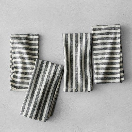 Dress up your dining table without being flashy with the Napkin Set from Hearth & Hand™with Magnolia. These simple striped napkins have a traditional look that'll make a great addition to your home decor. The black and cream color combo makes these cloth napkins easy to coordinate with your dishware and dining room decor for a cohesive look. <br><br>Celebrate the everyday with Hearth & Hand — created exclusively for Target in collaboration ...