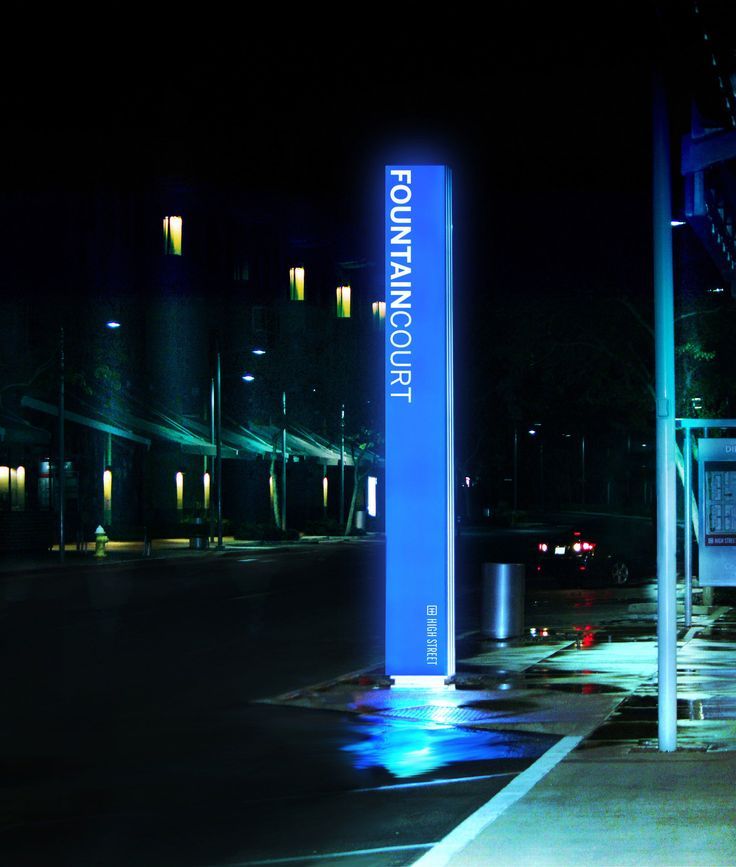Sixteen-foot tall illuminated vertical blades create branding and directional opportunities for the multi-use development.
