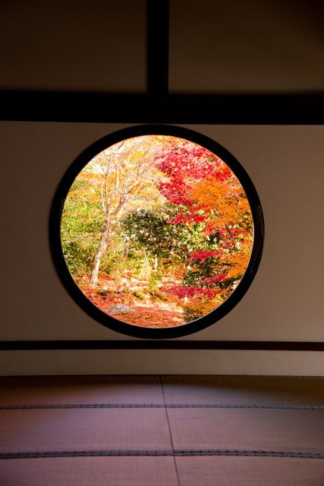 (Kyoto, Japan). Zen concept. A round window give you peace when looking the outside nature. Square windows interrupt this peace,  is aggressive and give a stress sensation