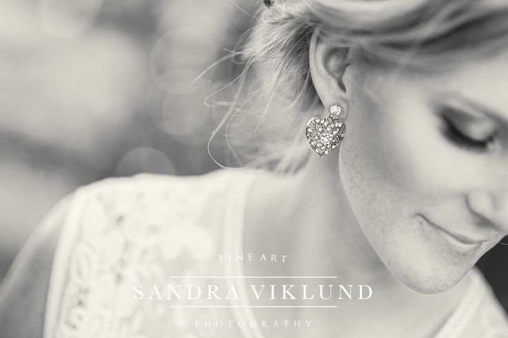 Bride portrait, blonde bridal hair with roses, lace wedding dress, eye lashes, diamond earrings