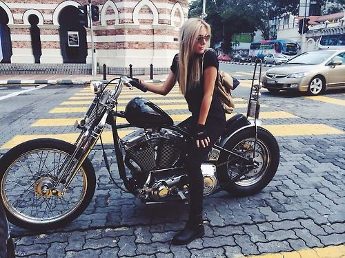 Moto blonde in black on a springer chopper with TearDrop tank