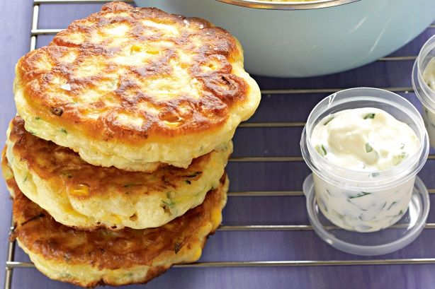 CORN & ZUCCHINI FRITTERS  2 eggs  1-1/5 cups self-rising flour  1 cup milk  2 corn cobs, kernels removed  1 zucchini, grated   oil - for frying  tzatziki dip - to serve