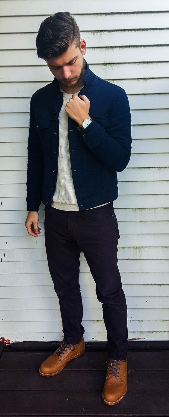 Go for navy denim jacket and black jeans for an easy to wear, everyday look. Rock a pair of khaki leather casual boots for a masculine aesthetic.   Shop this look on Lookastic: https://lookastic.com/men/looks/navy-denim-jacket-beige-crew-neck-sweater-black-jeans/17648   — Navy Denim Jacket  — Beige Crew-neck Sweater  — Black Jeans  — Tan Leather Casual Boots