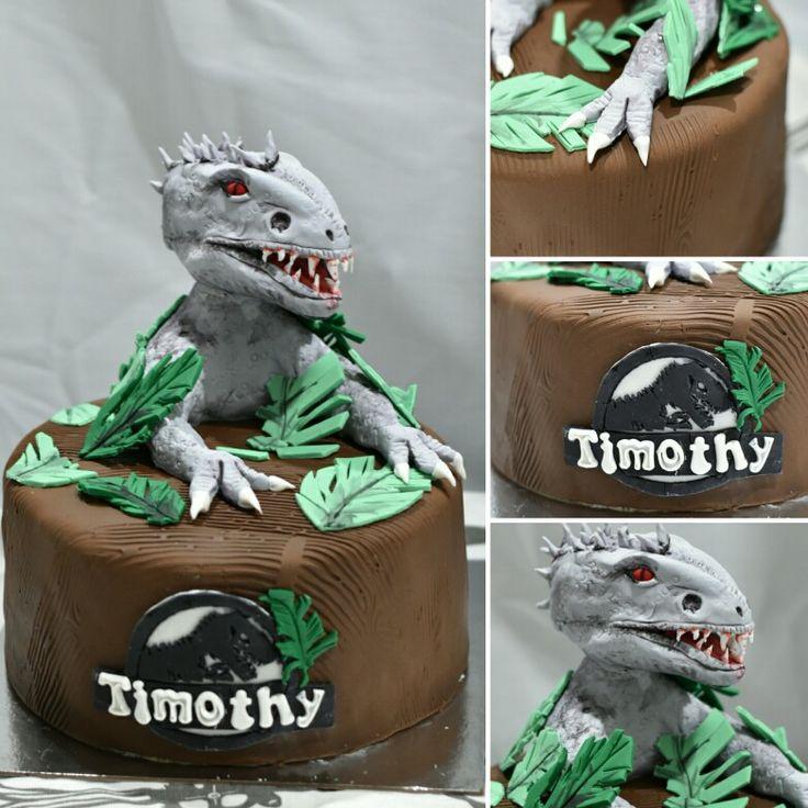 Indominus rex dinosaur - Jurassic world theme cake.  Fondant sugar paste figurine.  4 layer vanilla Cake with Swiss meringue vanilla frosting.
