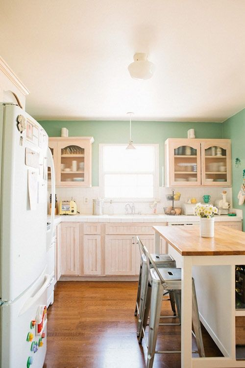 Lovely kitchen. Loving the wall color. I'd choose different chairs though.